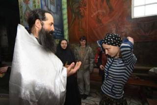Фото Олега Нехаева. Обряд крещения.